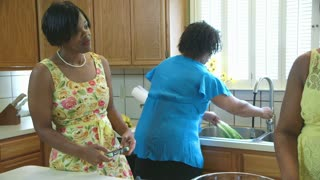 three african american women talking in the kitchen