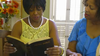 three women reading the bible.