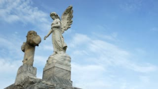 tilt from angel to tombs in Metairie cemetery New Orleans
