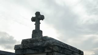 tilt from cross on tomb to row of tombs in Metairie Cemetery New Orleans