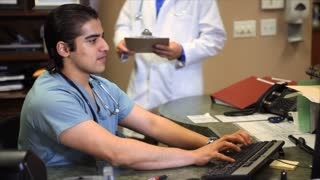 tilt up doctors at desk smile at camera
