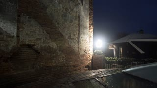tilt up in a night scene of an old brick wall 4k