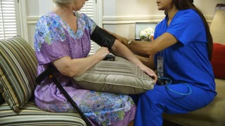 tilt up to home healthcare nurse putting on blood pressure cuff