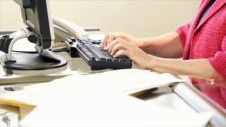 tilt up woman office worker on phone