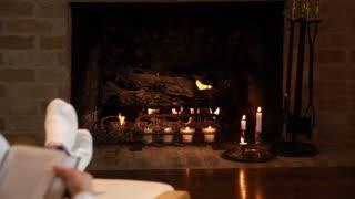 tilt woman reads book at fireplace