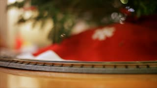 Toy train around the Christmas tree