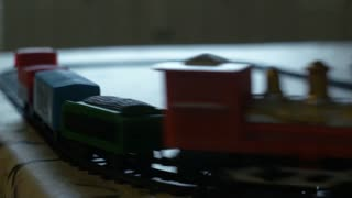 toy train moving on its track on a table 4k