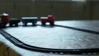 toy train traveling around its track 4k