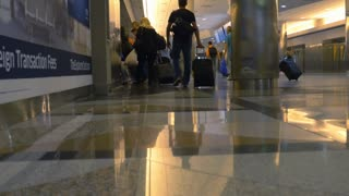 travelers waiting for the airport train denver colorado 4k