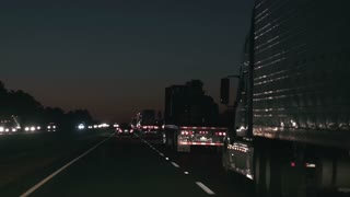 trucks transporting freight on interstate highway at night