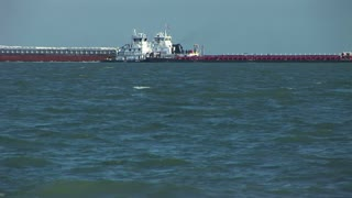 tugs crossing in the gulf of mexico
