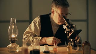 turn of the century scientist looking at a chemical and taking notes 4k