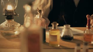 turn of the century scientist moves a lamp closer to the microscope 4k