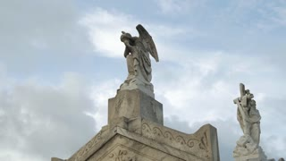 Two angels on top of a tomb in New Orleans cemetery