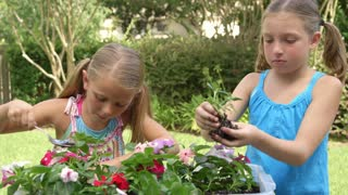 Two cute little girls planting smile at camera