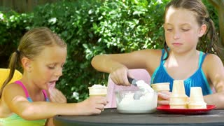 two little girls eating ice cream 4k