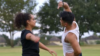 two people stretching after exercising in a park