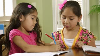 two sisters going over homework