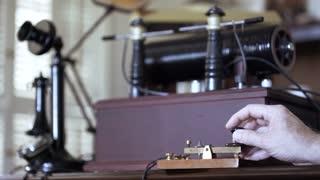 1912 radio operator sending morse code from a spark gap transmitter 4k