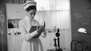 1930s nurse takes a phone call in the doctors office