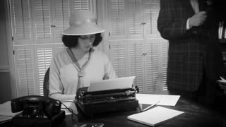 1940s female reporter typing