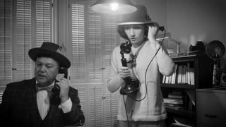 1940s Reporters working the phones female grabs camera and exits