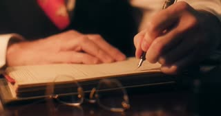 40s businessman using a fountain pen writing in the company ledger 4k