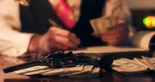 40s gangster writing in ledger focus on pistol and money 4k