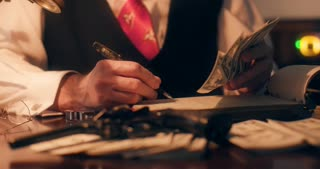 40s mob gangster counting money and writing in a ledger 4k