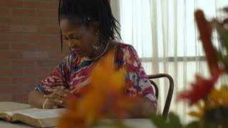 A Lovely African American Woman Spends Quiet Time Reading Her Bible