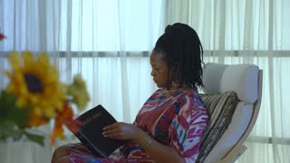 A woman is encouraged after reading her Bible and being in prayer