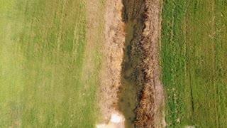 Aerial Establishing Shot Flying Along A Flood Drainage Ditch
