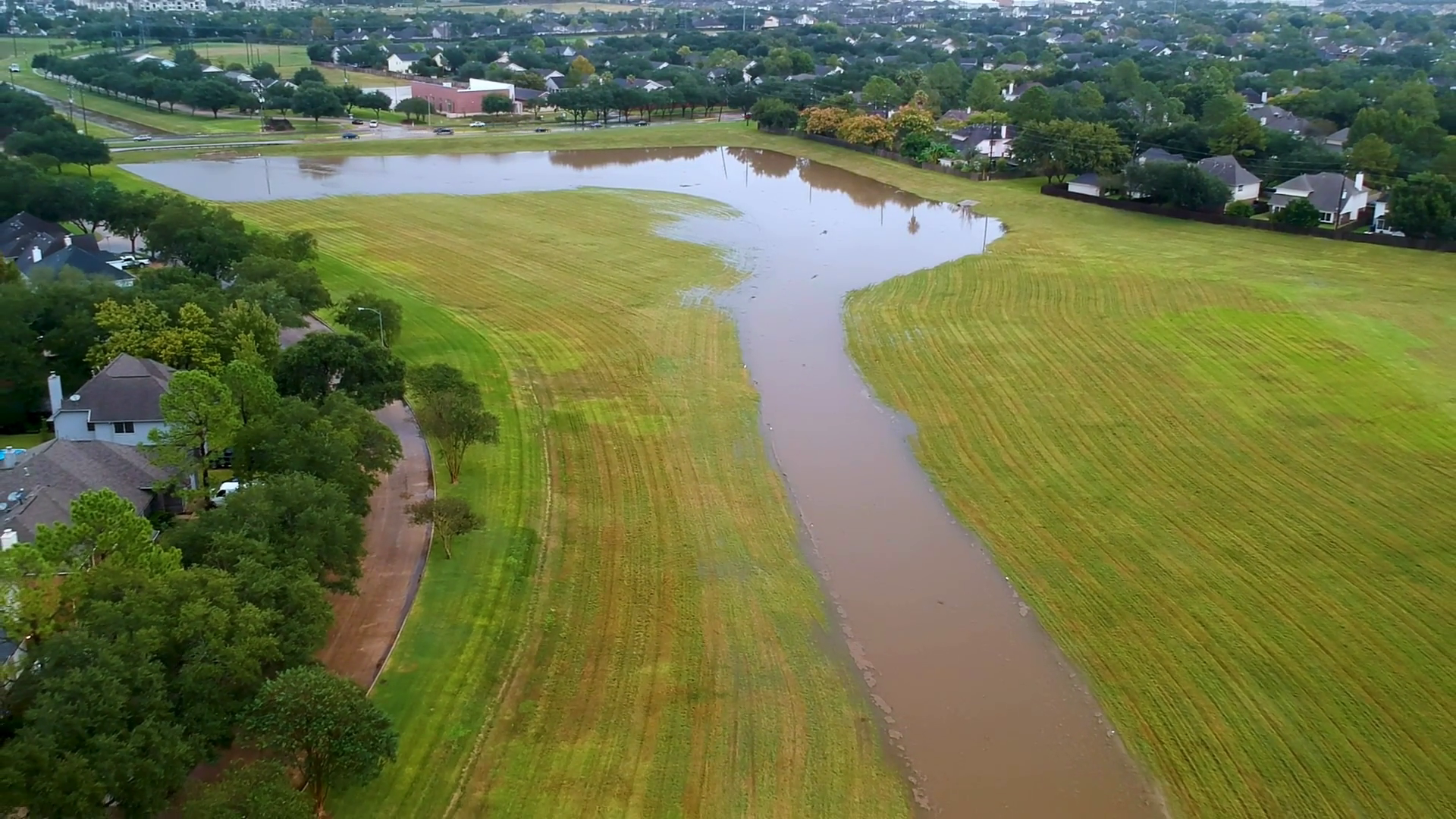 aerial pull back from flooded detention basin to subdivision Stock Video  Footage - Storyblocks