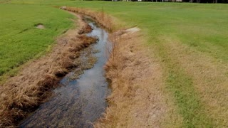 Aerial Shot Showing The Flow Of Water In A Drainage Ditch