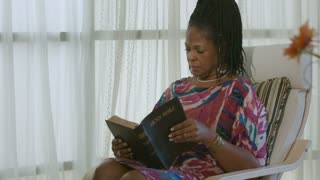 African American Woman Time in the Word Leads to Prayer