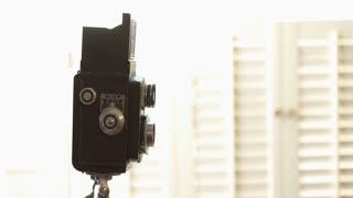 Backlit Photographer Using A Vintage Tlr Camera