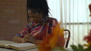 Bible reading leads to fervent prayer for this lovely African American woman