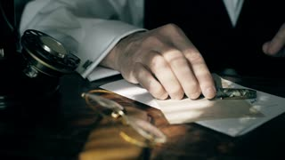 businessman in 1930 uses a fountain pen to write in a ledger 4k