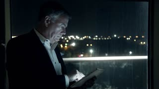 businessman working late at night using a tablet pc 4k