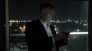 businessman working late in his office texting 4k