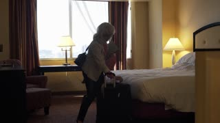 businesswoman ceo leaving her hotel room with suitcase 4k