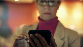businesswoman using her smart phone in cafe focus on phone 4k