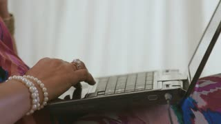 Close Up Laptop And Credit Card Use To Shop On Line By Woman