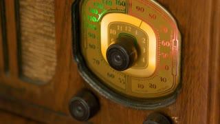 Closeup Of A Man Tuning A Vintage Radio Dial 4 K