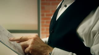 closeup of businessman looking at paperwork in office