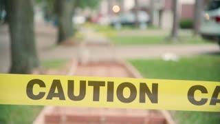 closeup of caution tape for sidewalk repair
