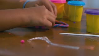 Closeup Of Little Girls Hands Working On Her Craft Project 4 K