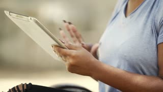 closeup of woman using a tablet pc outdoor 4k