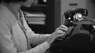 closeup of woman vintage news reporter typing a story