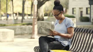 college girl sitting on campus using a tablet pc 4k